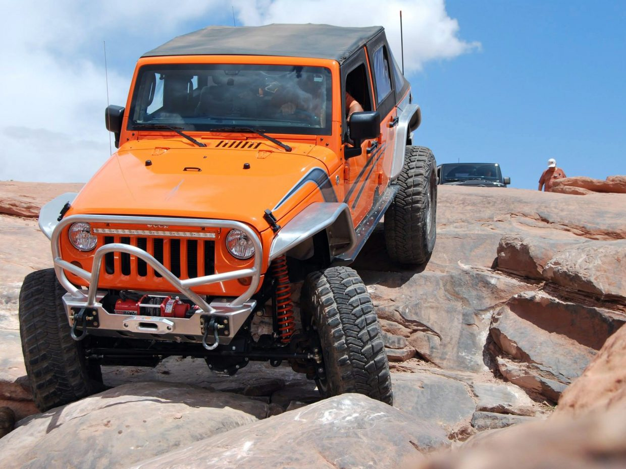 A Jeep maneuvers through a rock trail outside Moab, Utah. Eastern Utah's deserts are a required pilgrimage for any Jeep owner.