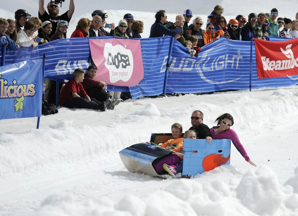 A family can comes down the course during the Cardboard Classic on Saturday at the Steamboat Ski Area.