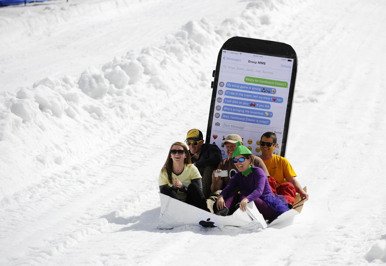 An iPhone with emoji characters comes down the course during the Cardboard Classic on Saturday at the Steamboat Ski Area.