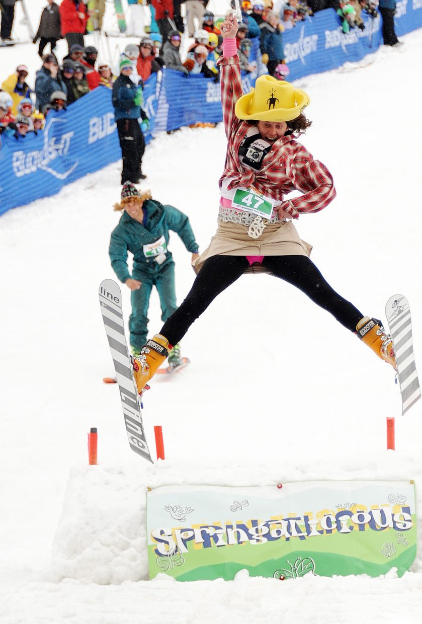 Tamra Malczyk flies off the kicker at the bottom of the pond skim run in Steamboat Springs. The event was canceled last year due to a lack of snow but will be back this year as part of the Steamboat Ski Area's Springalicious events.