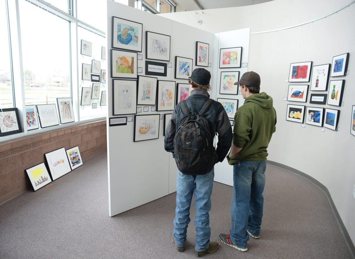 Tell Belton, left, and Will Anderson check out the art at the Steamboat Springs High School on Thursday evening. The show, put on by the AP Studio Art class opened Thursday and the show can be views during the school hours through May 2.