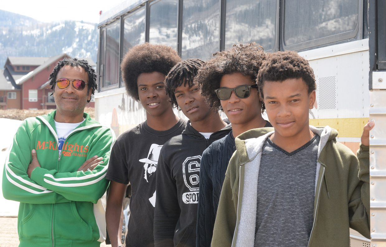 The Groovetrotters, shown in front of the group's tour bus, travel around the country bringing a mix of jazz, funk, reggae and rock all melded into a controlled jam session. This is a family group with dad Marcel Groovetrotter leading the way on guitar and his sons Pierre, Jerome, BJ and Claude filling out the group.