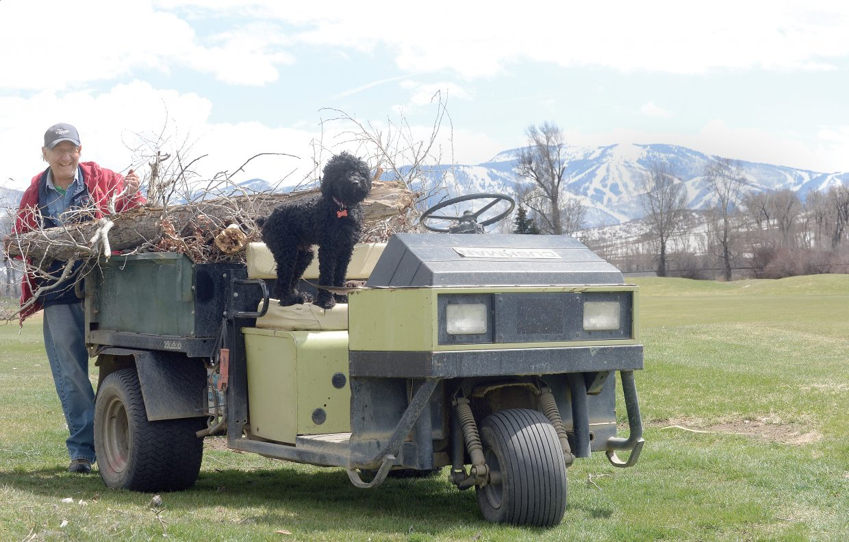 Longtime Steamboat Golf Club member and volunteer Blaze Arigo cleans up branches at the golf course west of Steamboat Springs on Thursday afternoon. The 9-hole course is planning to open Saturday morning if the weather cooperates.