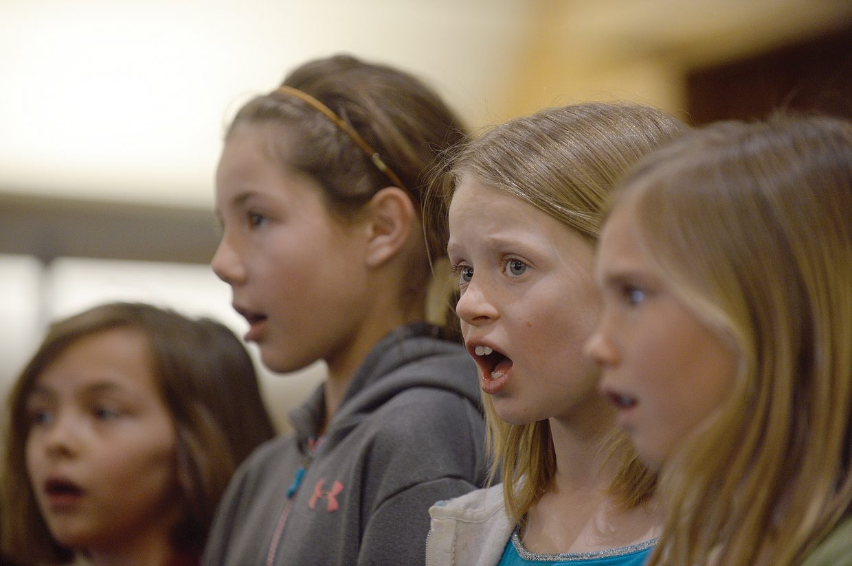 Kaelia Buschmann, Brieanna Romero, Ashley Anfang and Jasmine Carrell rehearse for the children's section of the Yampa valley Singers' spring performance. The Yampa Valley Singers will host its annual spring concert at 7 p.m. Friday and 4 p.m. Saturday at the United Methodist Church in Steamboat Springs.