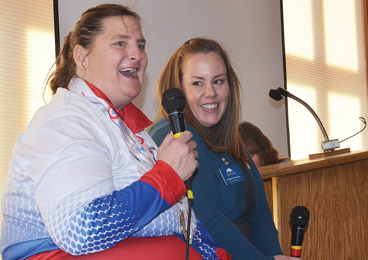 Sue White, just back from Austria, take questions from the crowd of people who had come out to celebrate her gold medal showing in the giant slalom event at the 2017 Special Olympics World Winter Games. She was joined on stage at Olympian Hall by Horizon's employee Meghan McNamara, who used vacation time and spent her own money to make the trip to support White at the Games.