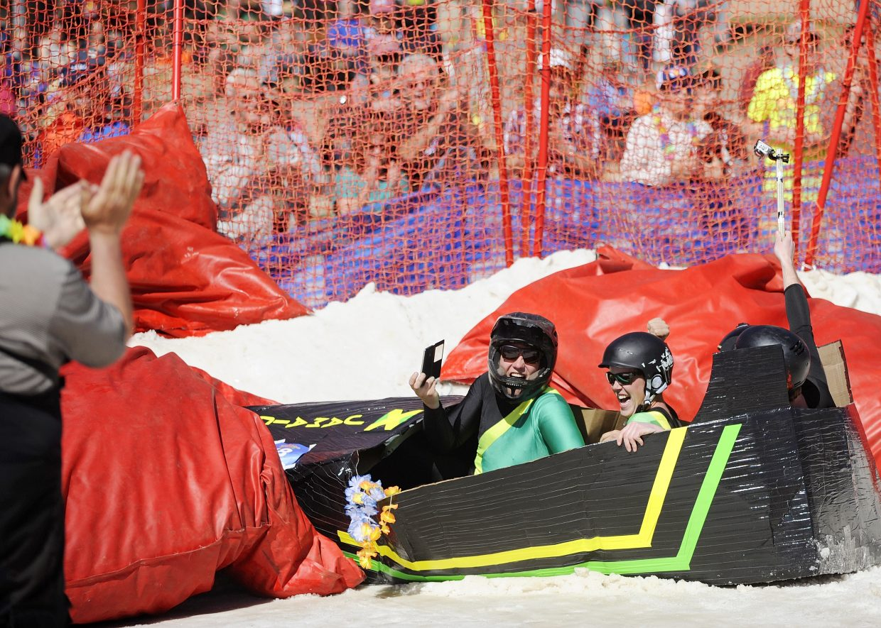The Jamaican Bobsled Team crashes during the Cardboard Classic on Saturday at the Steamboat Ski Area.