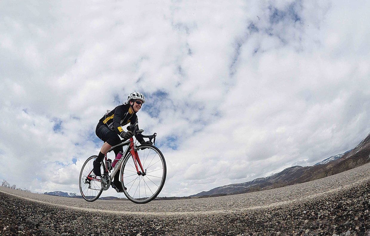 Cyclist Michelle Freckleton spent her lunchtime putting a few miles on her road bike Monday afternoon. There where plenty of clouds, but warm temperatures seemed to dominate the day and gave locals a chance to get out for some springtime activities.