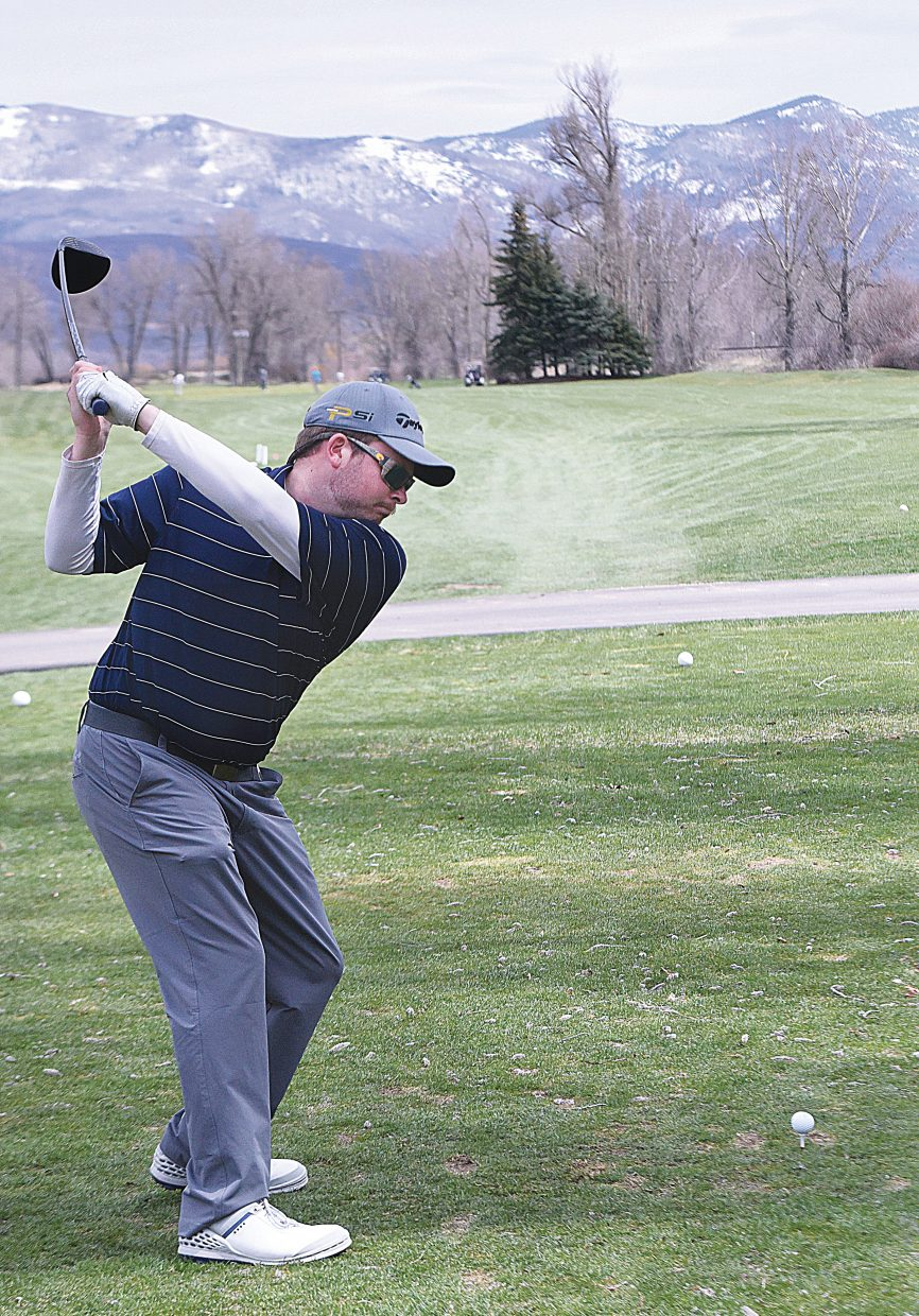 Golfer Dean Domingue tees off at the Steamboat Golf Club Tuesday afternoon. The club opened for the 2017 season April 1.