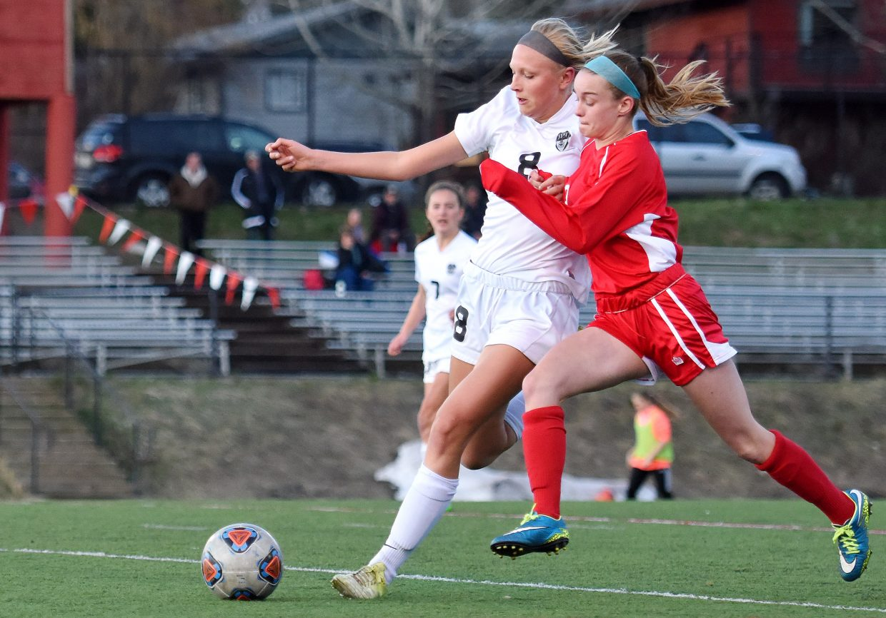 Steamboat junior Maggie Henry stretches to beat her opponent for a ball Tuesday as the Sailors knocked off Glenwood Springs, 3-1. Henry had one assist in the game, as did senior Mackenzie Gansmann.