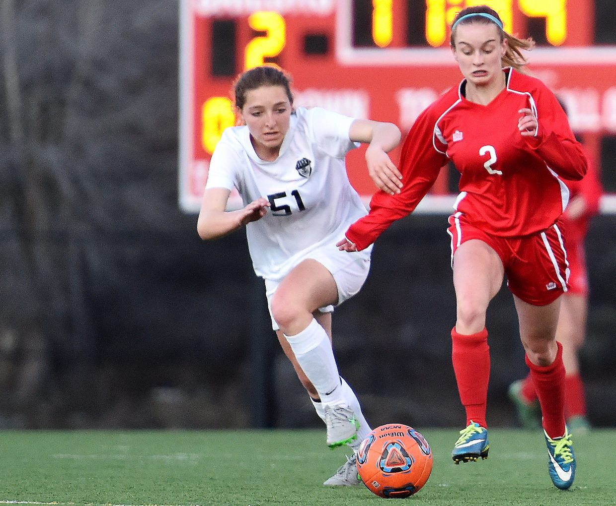 Steamboat's Teegan Ludwick, left, tries to chase the ball down Tuesday against Glenwood Springs.