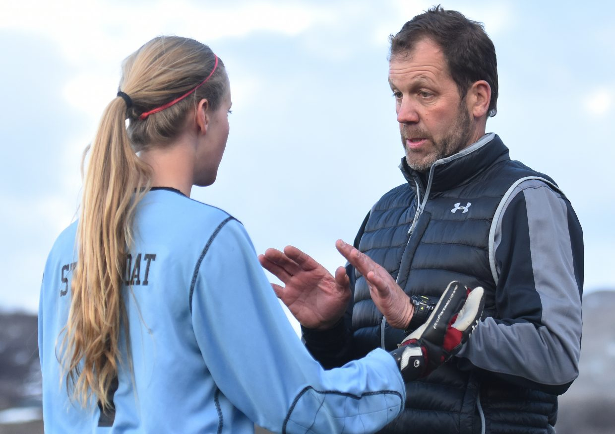 Steamboat coach Rob Bohlmann talks with goalie Ocoee Wilson on Tuesday after she had to sub out of the game with a yellow card.