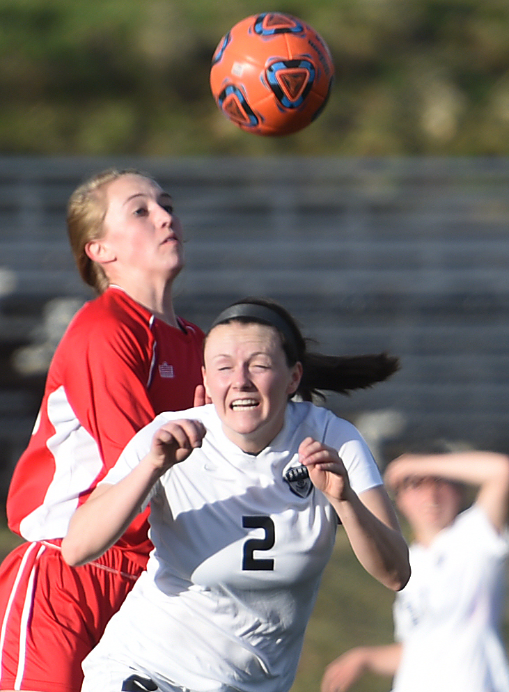 Steamboat's Jordi Floyd winches after bumping the ball with her head Tuesday.