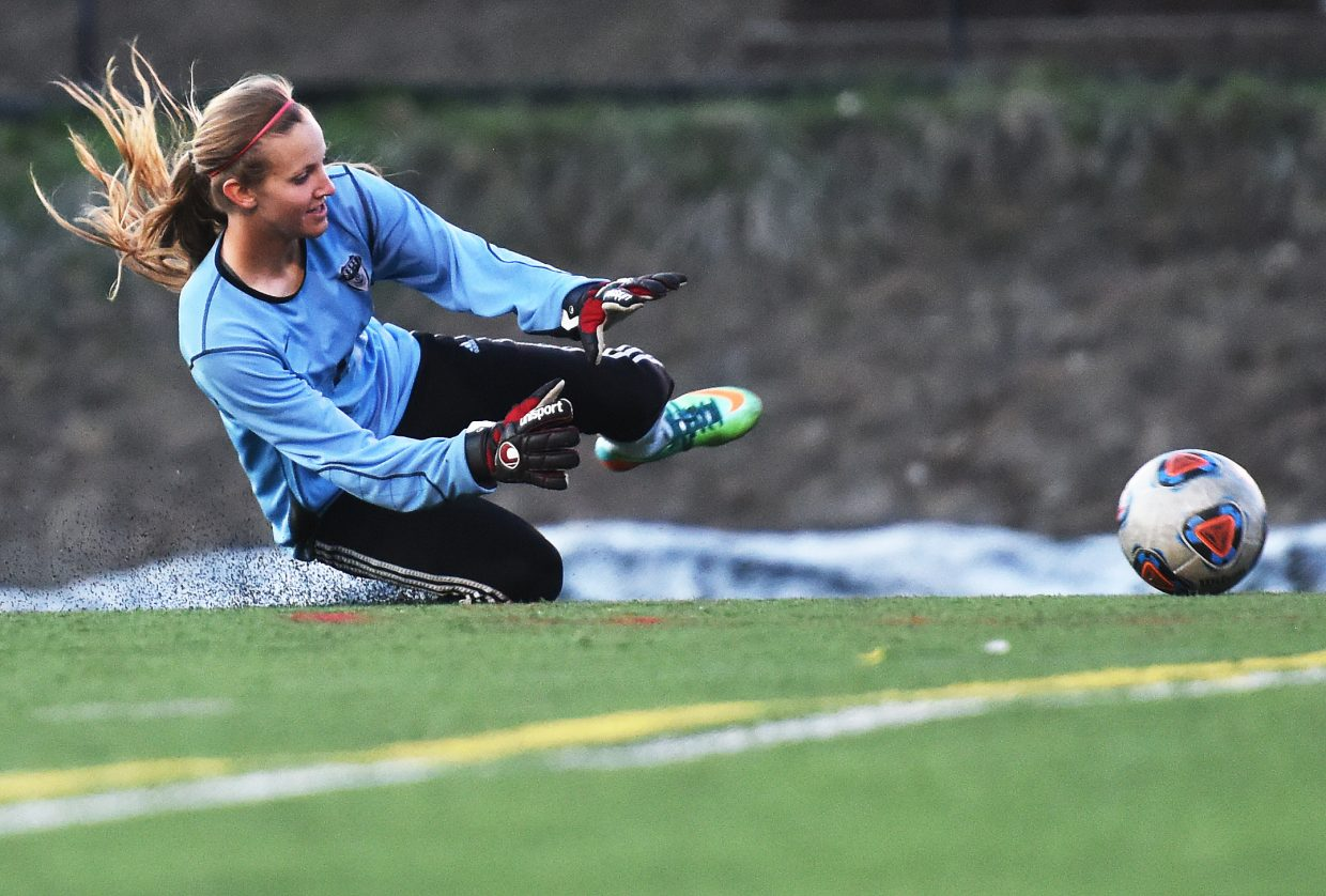 Steamboat's Ocoee Wilson hits the turf for a save Tuesday.
