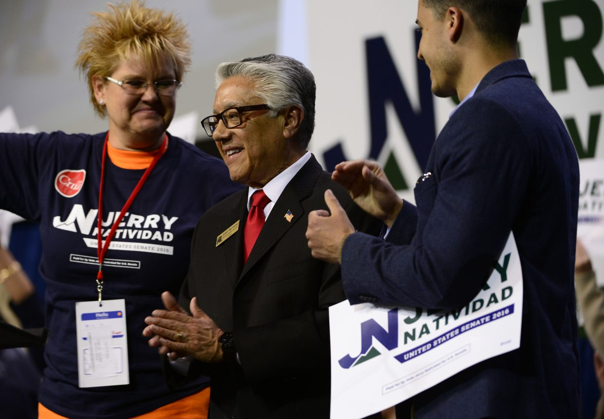 Routt County Treasurer Brita Horn, left, listens as Jerry Natividad, U.S. Senate candidate, addresses the crowd during the 2016 Colorado State Republican Convention at the Broadmoor World Arena in Colorado Springs on Saturday. Horn has been selected as a state delegate to the Republican National Convention in Cleveland.
