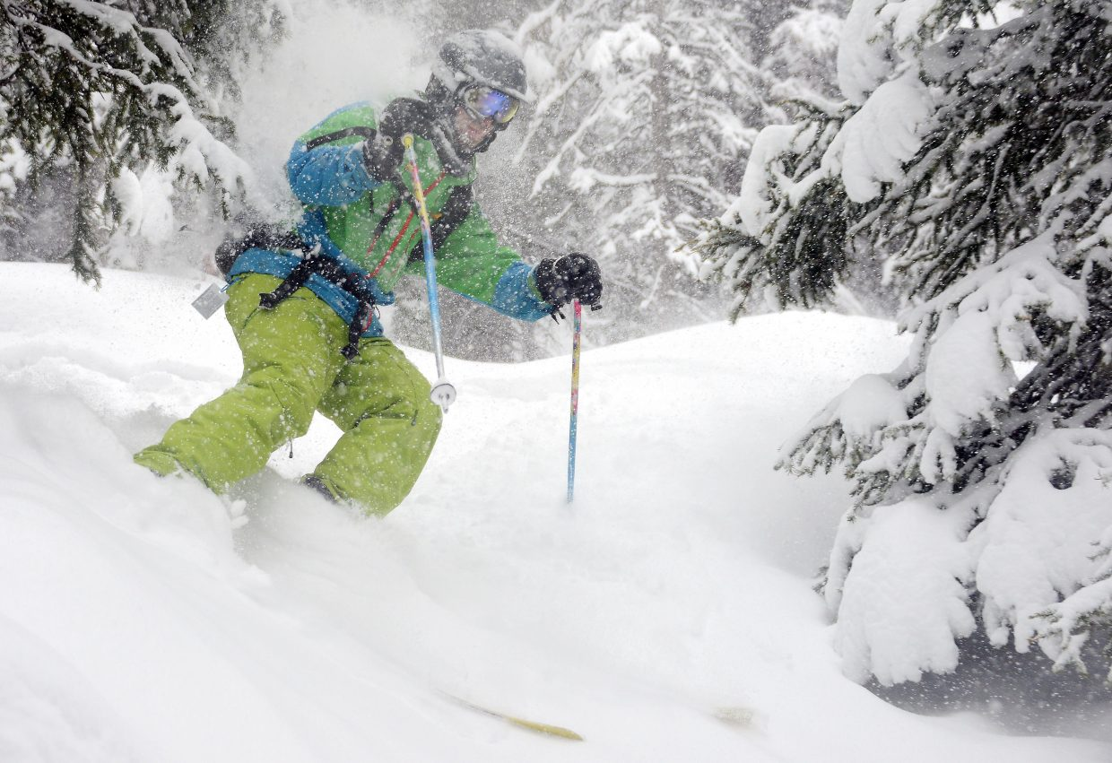 Colorado Mountain College student Brett Somen cuts through the trees at Steamboat Ski Area on Sunday, the resort's closing day. Somen skied 119 days at Steamboat and 149 overall, every day but one during the season. He also didn't miss a class and maintained a 3.5 GPA while working on a sustainability bachelor's degree.