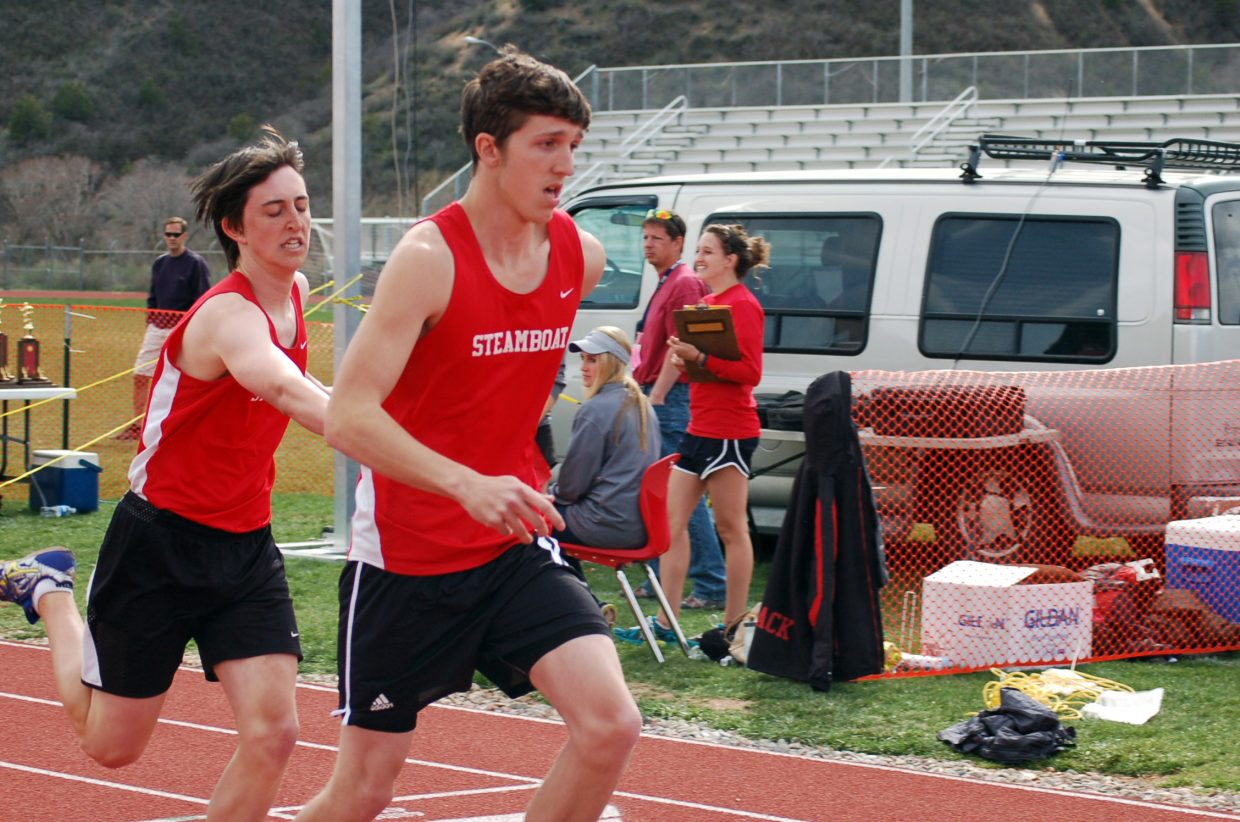 Charlie Tish hands off to Josh Corbin during the boys 1,600-meter relay at Glenwood Springs.