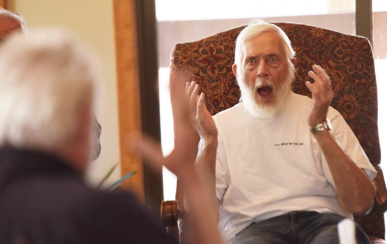 David Goldberg, who has Parkinson's disease, practices his surprise breathing techniques during a workshop at the Rolling Stone Respite House in Steamboat Springs, where the local Parkinson's group met Wednesday. The Emerald City Opera helped bring Dan Comstock, a voice coach and therapist, to Northwest Colorado this week. Comstock used music to help the group with speaking and communicating through flow and posture. He also hosted sessions with Horizons Specialized Services, in Steamboat Springs and Craig, and conducted a workshop for caregivers.