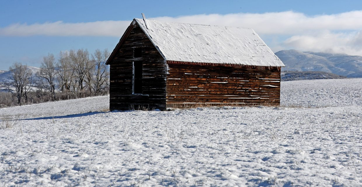 Fresh snow dominates the landscape surrounding this small outbuilding west of Steamboat Springs.