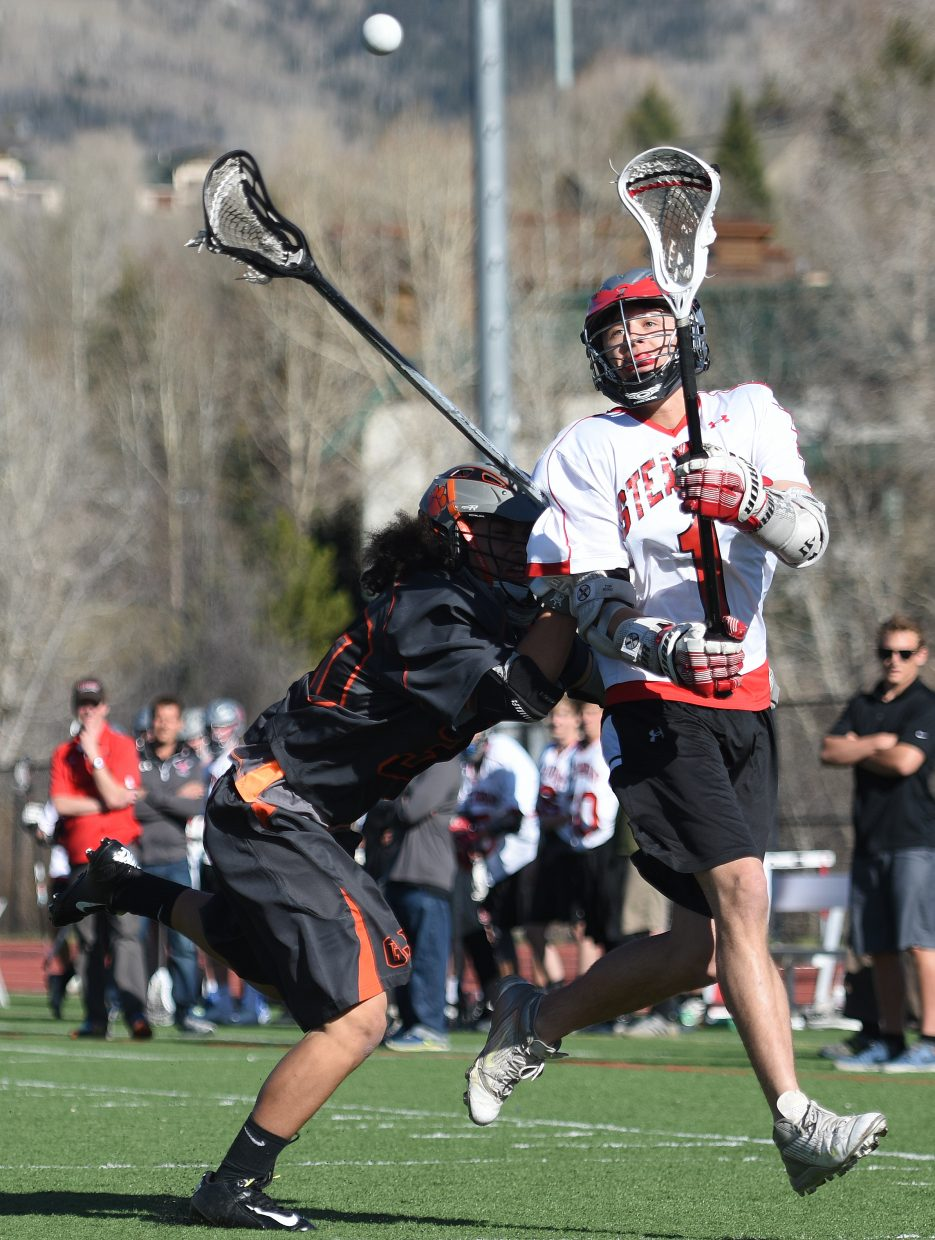 Steamboat's Zach Rosa lets loose a shot Tuesday afternoon against Grand Junction. He scored one goal in the game, helping list the Sailors past the Tigers, 11-6.