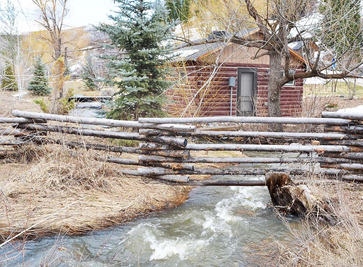 Butcherknife Creek flowed close to an Old Town Steamboat home at the east end of Spruce Street April 14.