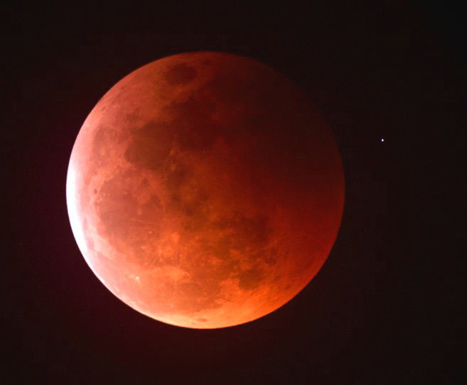 Earth's moon as it appears during a total lunar eclipse, known as the Blood Moon. It will next appear this way in October.