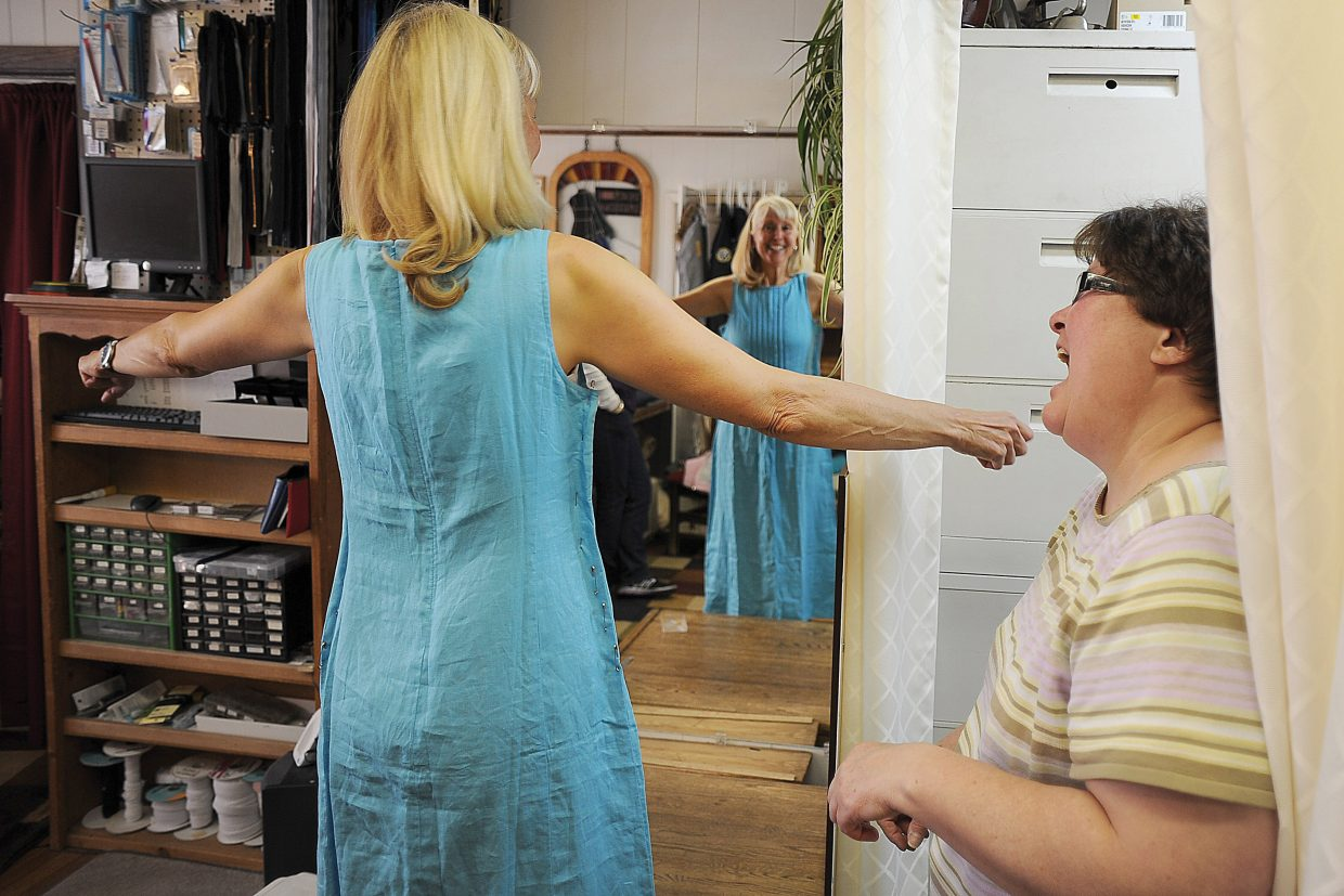 Sandy Clavadetscher works with Sew What employee Trish Tomme to alter a dress at the shop in downtown Steamboat Springs.