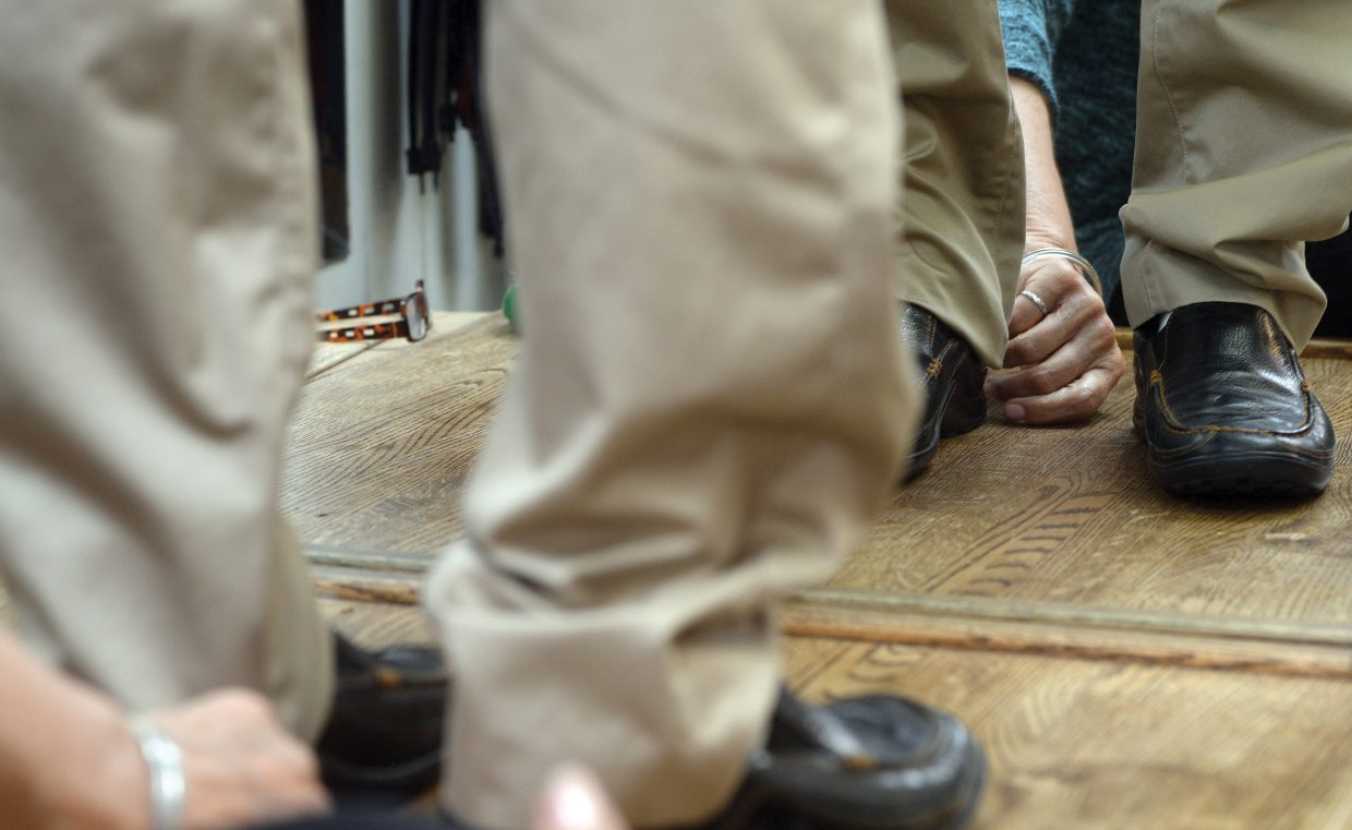 Sew What owner Maggie Bentz marks a pair of pants to be shortened inside her downtown Steamboat Springs shop.