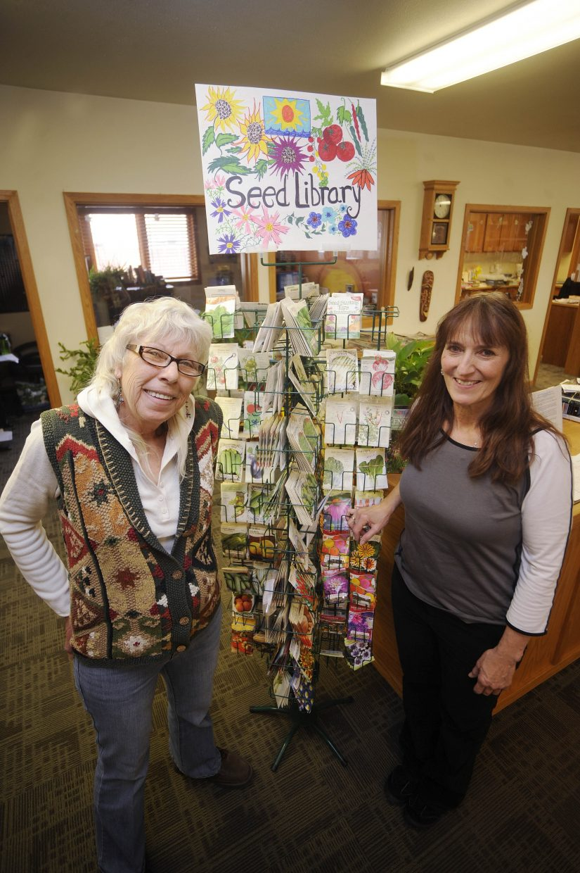 Hayden resident Anne Daugherty, left, worked with librarian Ana Lash to establish the town's Hayden Community Seed Library.
