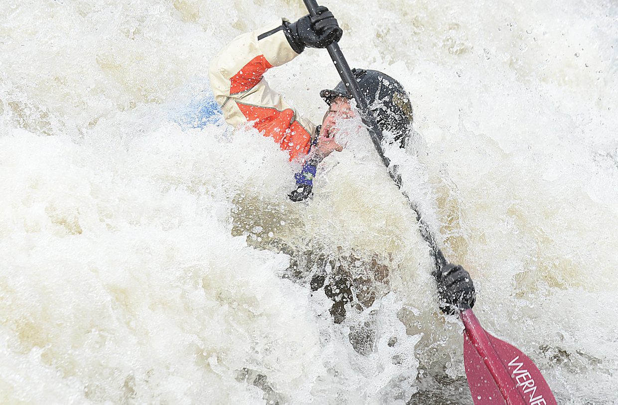 Casey Durbin found himself immersed in whitewater while kayaking in the Yampa River on Wednesday afternoon. Warm temperatures and plenty of melting snow have pushed the Yampa River to the point at which local kayakers are being drawn to the fast-moving waters.