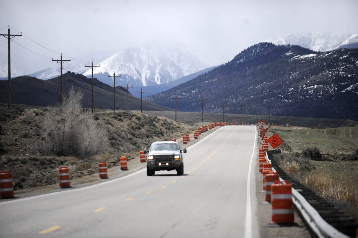 A truck travels Thursday morning along the six-mile stretch of Colorado Highway 9 construction zone between Kremmling and Silverthorne, where improvements are being made to keep wildlife off the road. There were no delays around 11:30 a.m., but Colorado Department of Transportation officials advise travelers to plan for up to 45-minute delays.