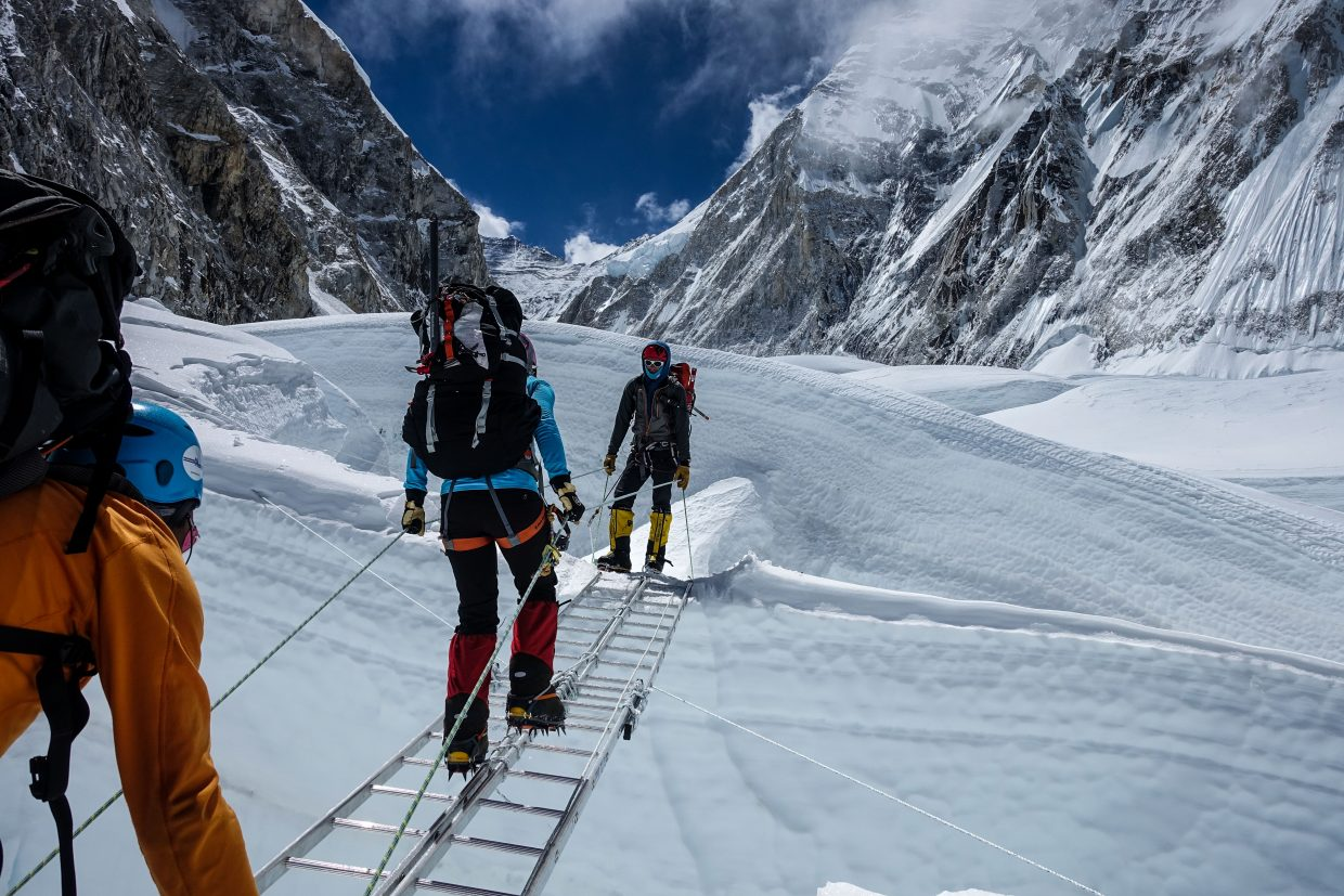 Climbers make their way over a crevice in the Khumbu Ice Fall during Kim Hess's 2015 attempt to reach teh summit of Mount Everest. An earthquake destroyed the tenuous path, leaving Hess and other climbers trapped above it. They had to be helicoptered to safety.