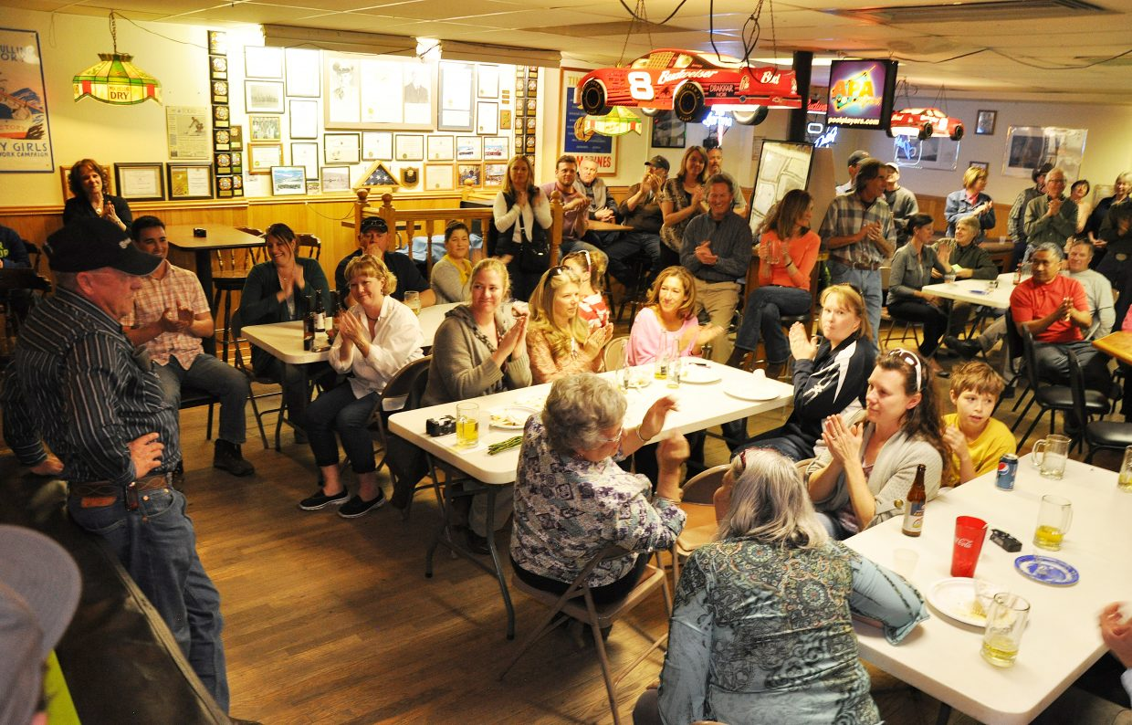 Friends and family applaud Joe Zimmerman, left, after his retirement speech Thursday afternoon at the Veterans of Foreign Wars lounge in downtown Steamboat Springs. Zimmerman worked for 39 years at the city of Steamboat Springs, spending most of his career as utilities superintendent.