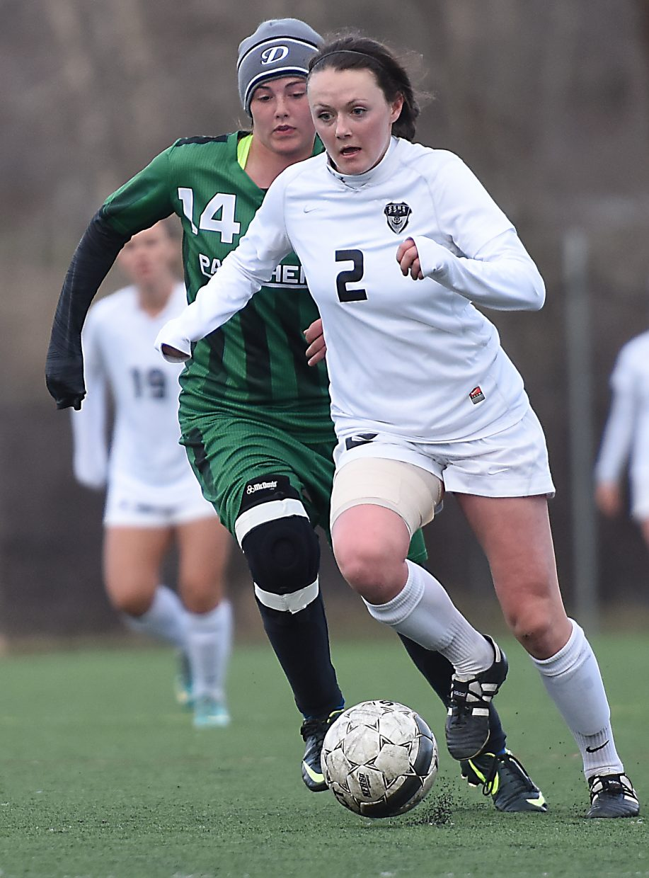 Jordi Floyd works her way up the field Friday.