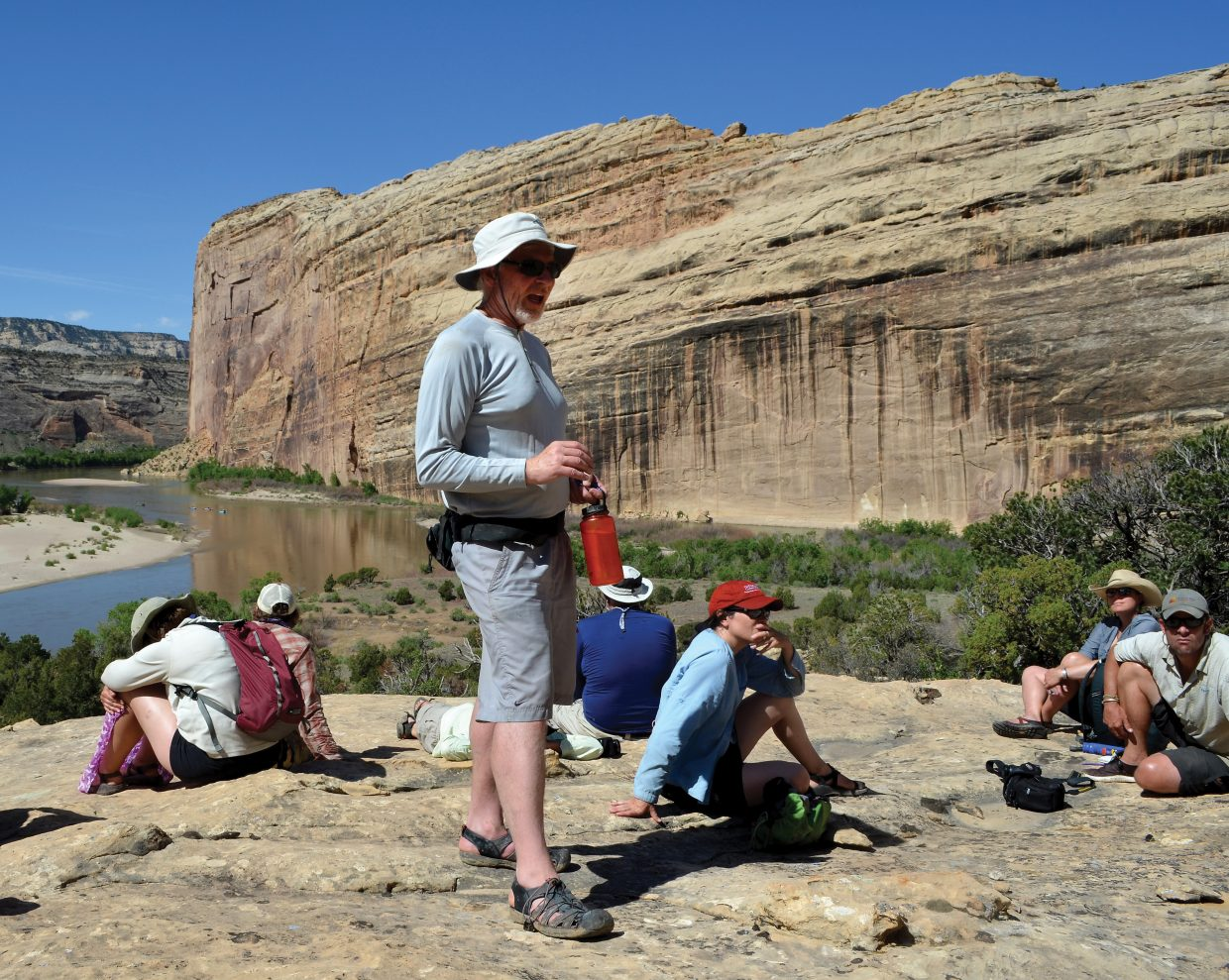 Eric Kuhn, general manager of the Colorado River District, explains the modern history of water politics affecting the Yampa River to a group of conservationists and policy makers near the confluence of the Yampa and Green rivers in Dinosaur National Monument in June 2013.