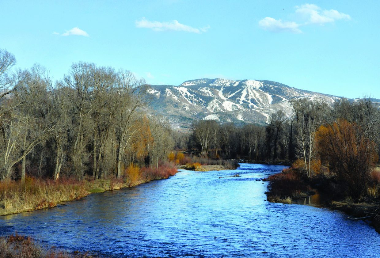 The water flowing down the Yampa River flows out of downtown Steamboat Springs is supplied by the snow-covered slopes of Mount Werner and the high peaks that surround the Yampa Valley.