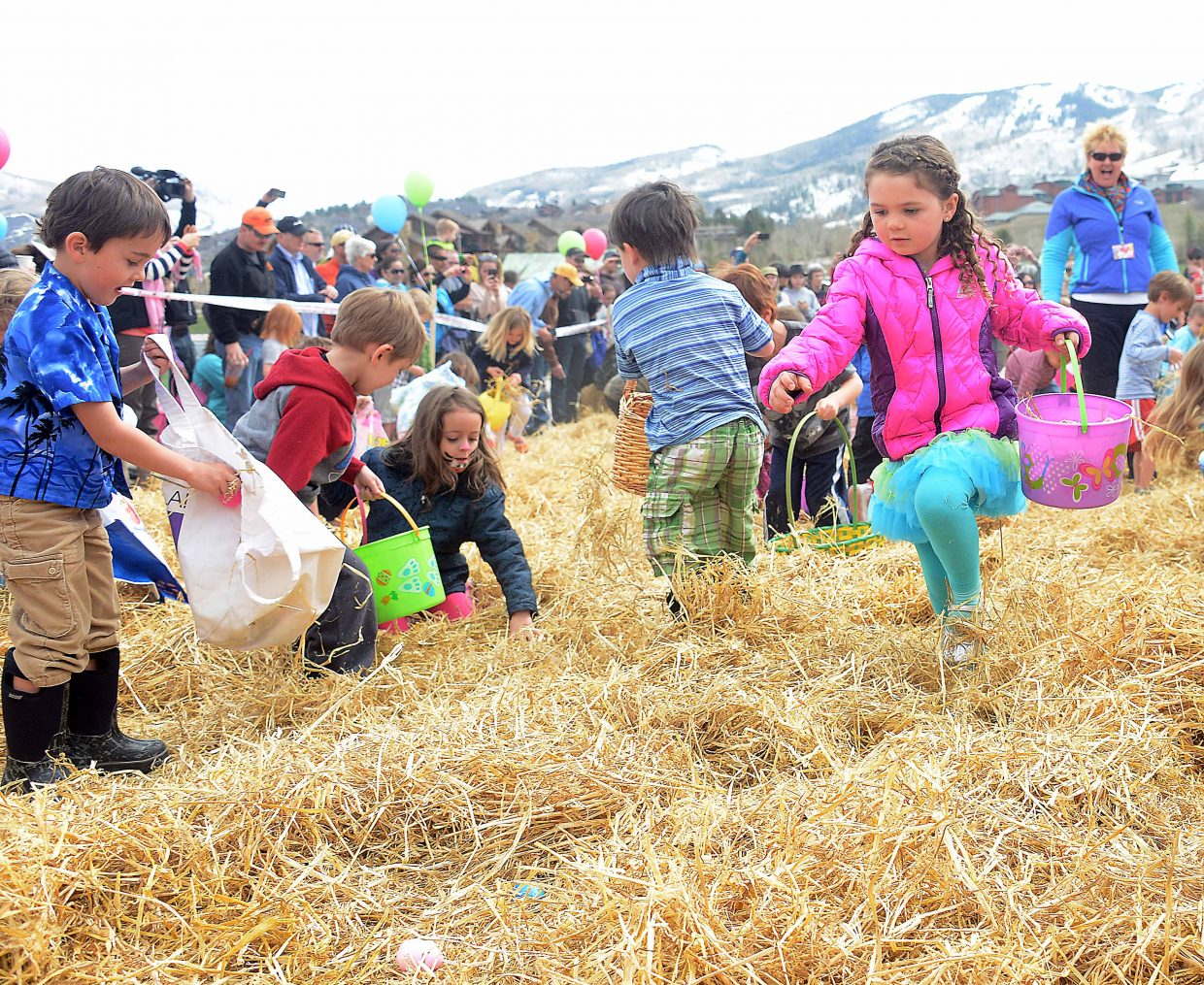 Peyton Carnes, 5, hunts for eggs Saturday at the Easter Eggstravaganza. The event runs from 10 a.m. to noon on Saturday at the Steamboat Springs Middle School for all ages.