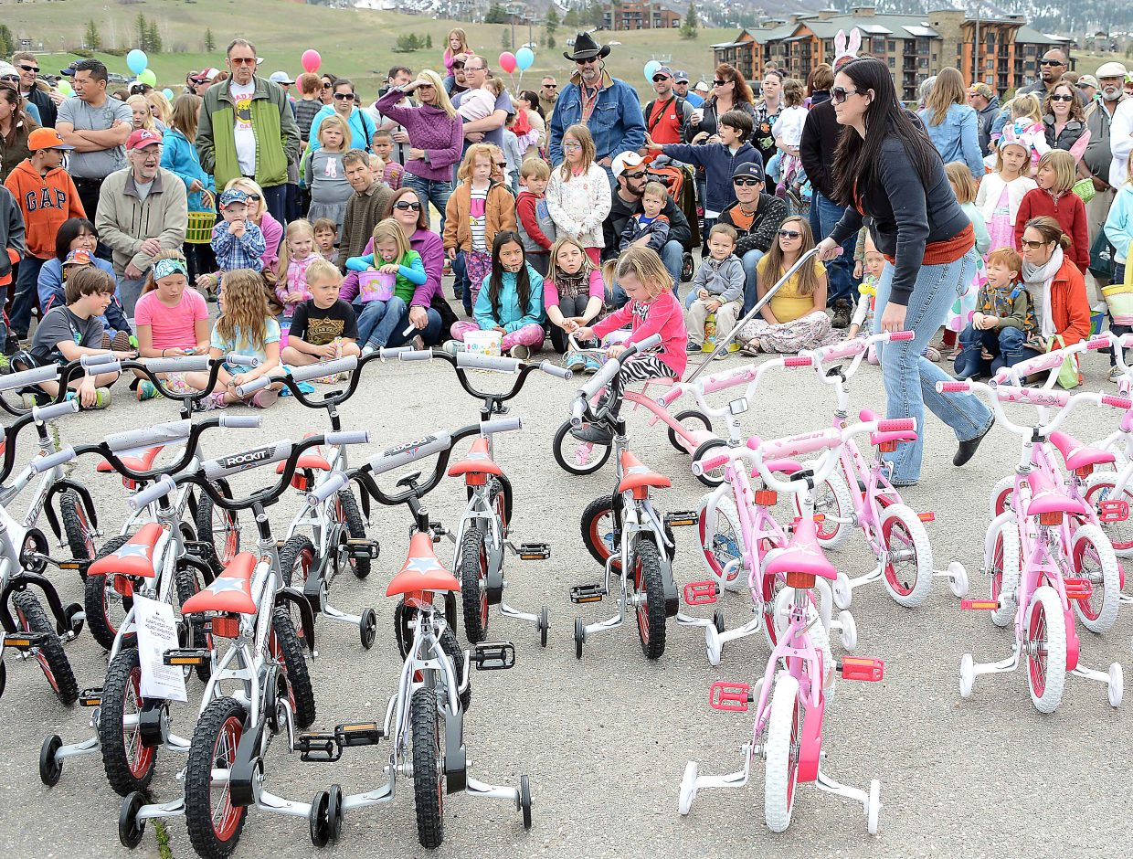 Isabella Mayer rolls away with her big win, a new pink tricycle. More than 100 bicycles were given away as a part of the Easter Eggstravaganza on Saturday at the Meadows parking lot in Steamboat Springs.