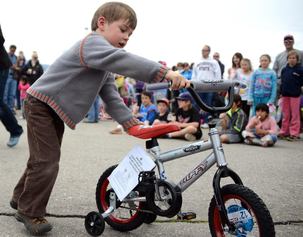 Jackson Tormey, 4, won a bike Saturday at the Easter Eggstravaganza at the Meadows parking lot in Steamboat Springs.