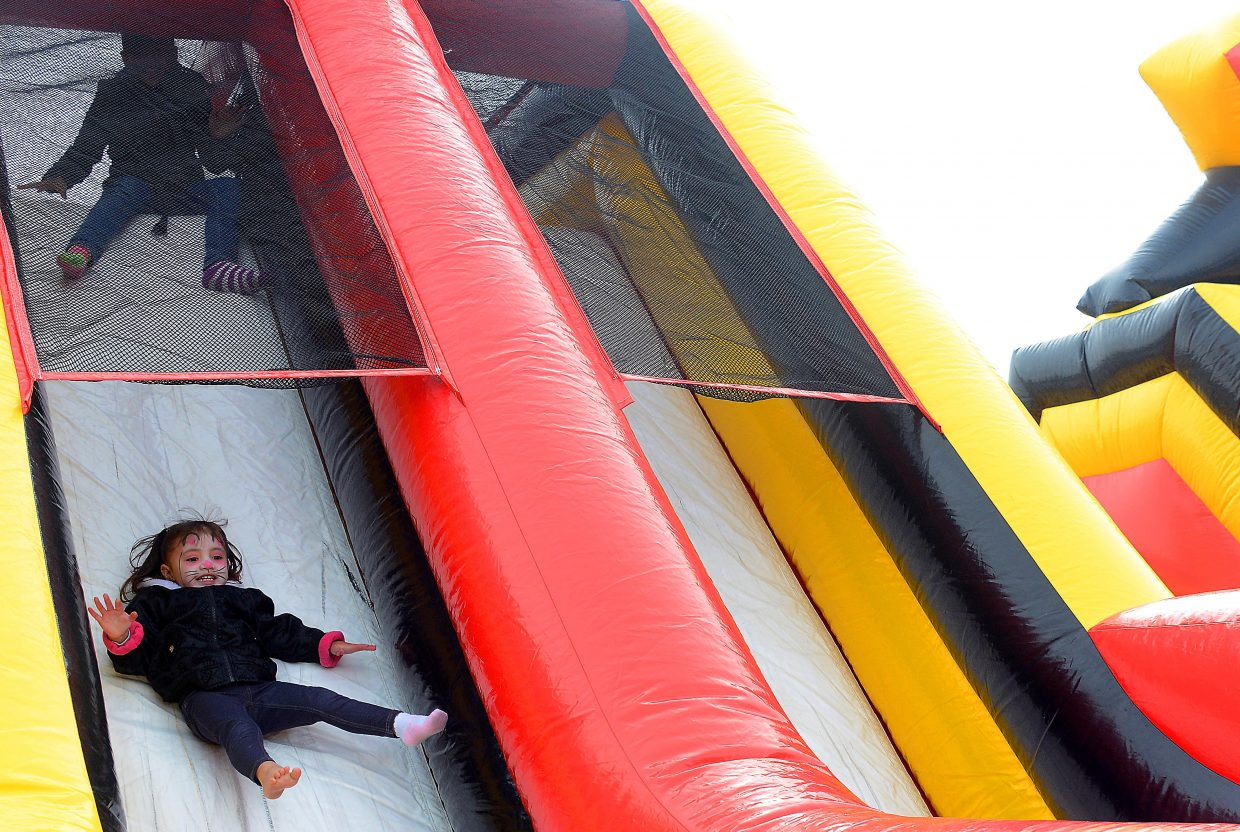 Analy Tarango, 2, enjoyed her ride down the slide of an inflatable ride Saturday at the Easter Eggstravaganza at the Meadows parking lot in Steamboat Springs. The event included a massive egg hunt, of course, but also face painting, rides, games and a huge bike giveaway.