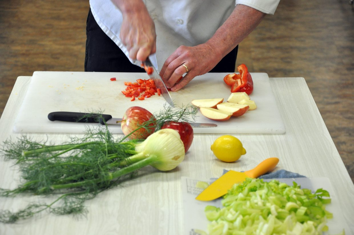 Hayden Nutritional Services Director Steve Carlson demonstrates some cutting techniques at a healthy cooking class in Hayden.
