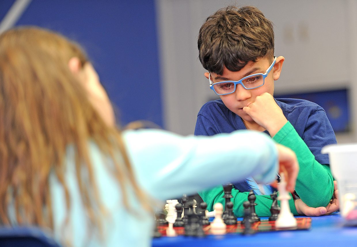 Jensen Oliveras ponders his next move in a game of chess against Baylee Walker on Wednesday at the Boys & Girls Club of Steamboat Springs.