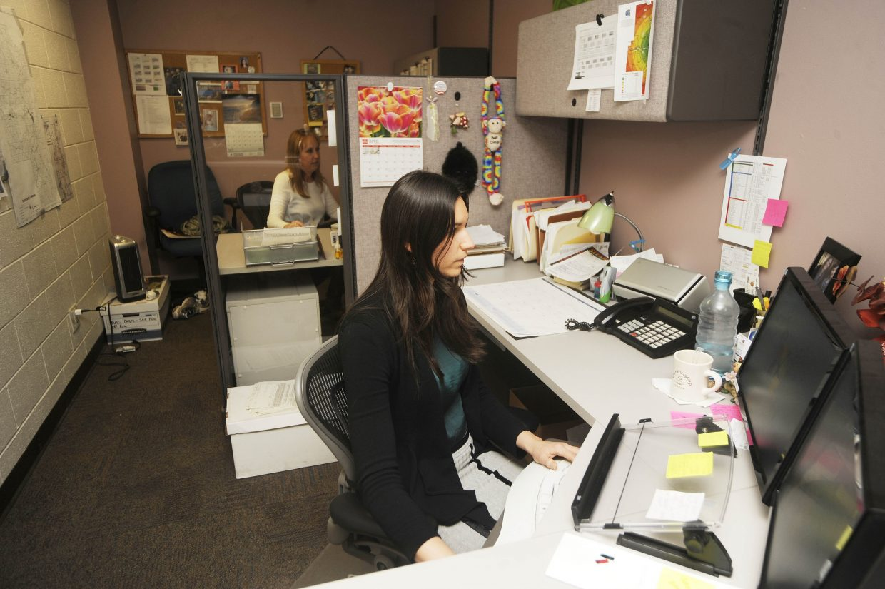 Routt County Sheriff's Office records technicians Jennifer Hubbard, right, and Jill Lamb work Tuesday.