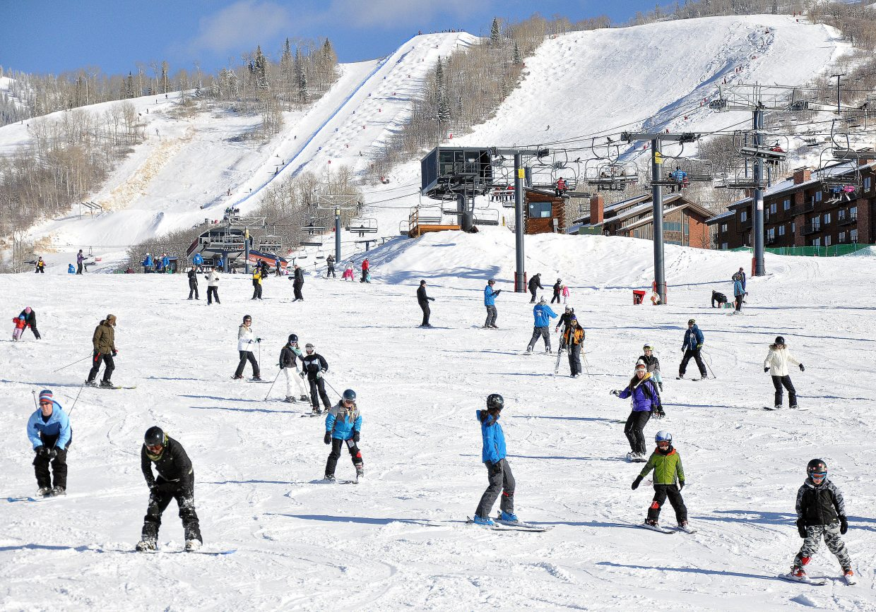 Skiers and snowboarders take advantage of six fresh inches of January powder during the low-snow winter of 2011-2012 at the Steamboat Ski Area. Steamboat parent company Intrawest reports an increasing share of overall ticket sales are season passes purchased before winter gets underway.