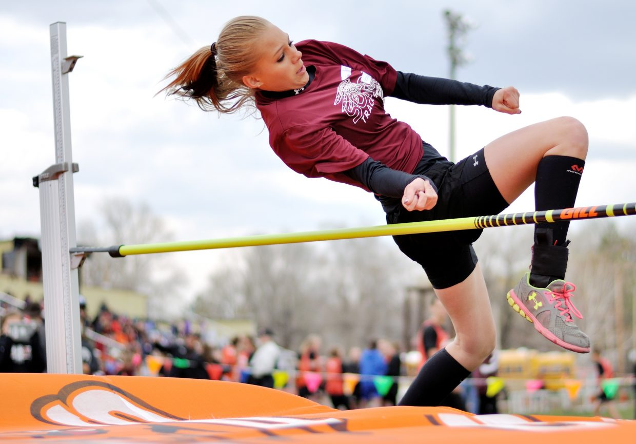 Soroco Middle School high jumper Justice Sales flies over the bar at a track met in Hayden. She went on to place second in the event.