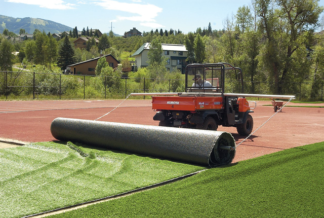 Steamboat Springs High School's artificial turf is unrolled onto Gardner Field in 2006. The turf was paid for in part by a $250,000 gift from the Education Fund.