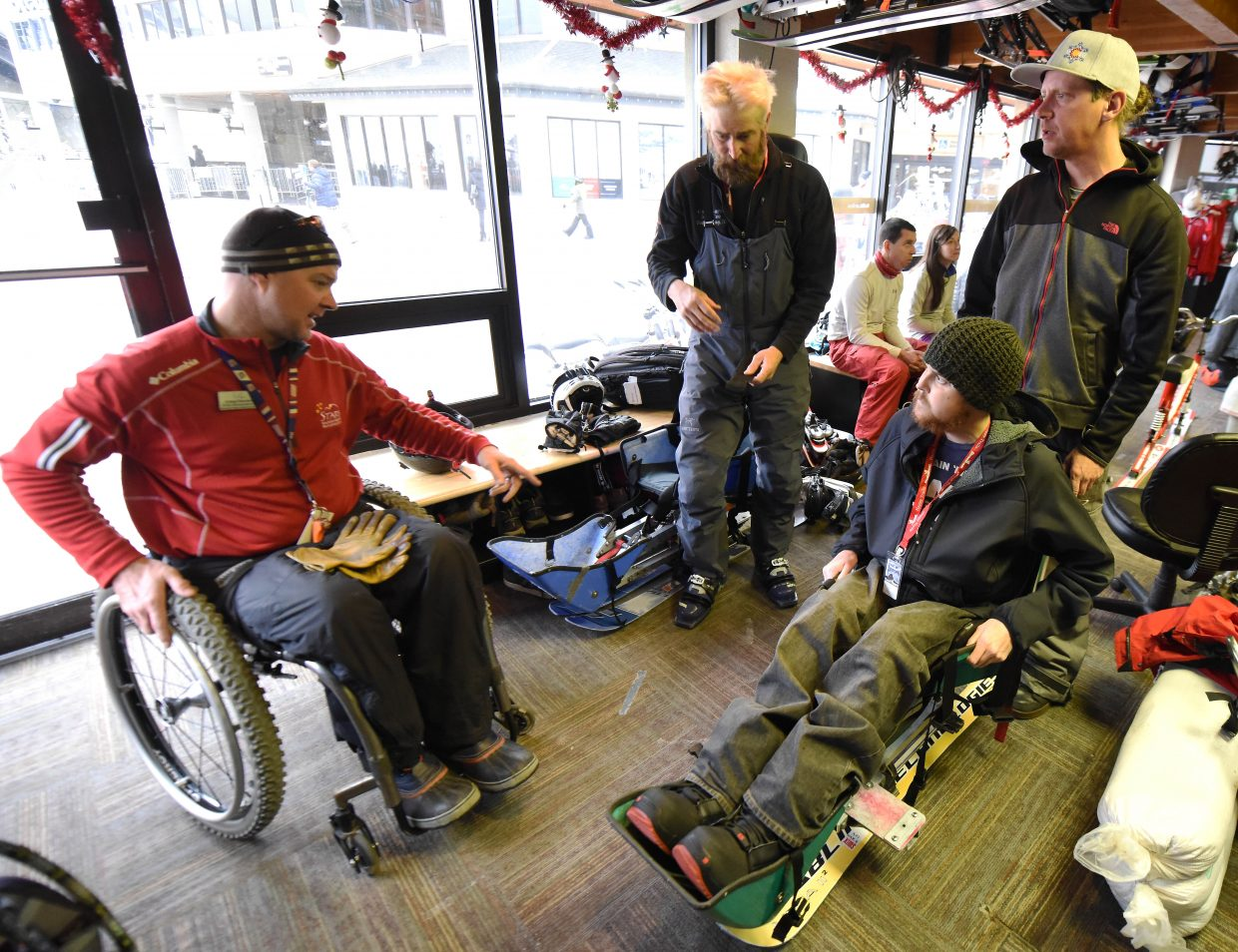 Craig Kennedy, left, helps U.S. Marine Brett Kerkhof adjust to a sit ski in December at Steamboat Ski Area. Kennedy worked with STARS for six years before moving on this spring.