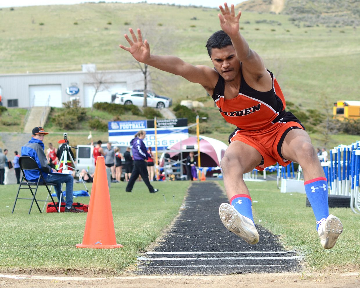 Hayden's Jack Redmond leaps to first place in the boys long jump on Friday at the Clint Wells Invitational at Moffat County High School in Craig. Redmond also placed second in the triple jump, adding to a strong showing by local athletes.