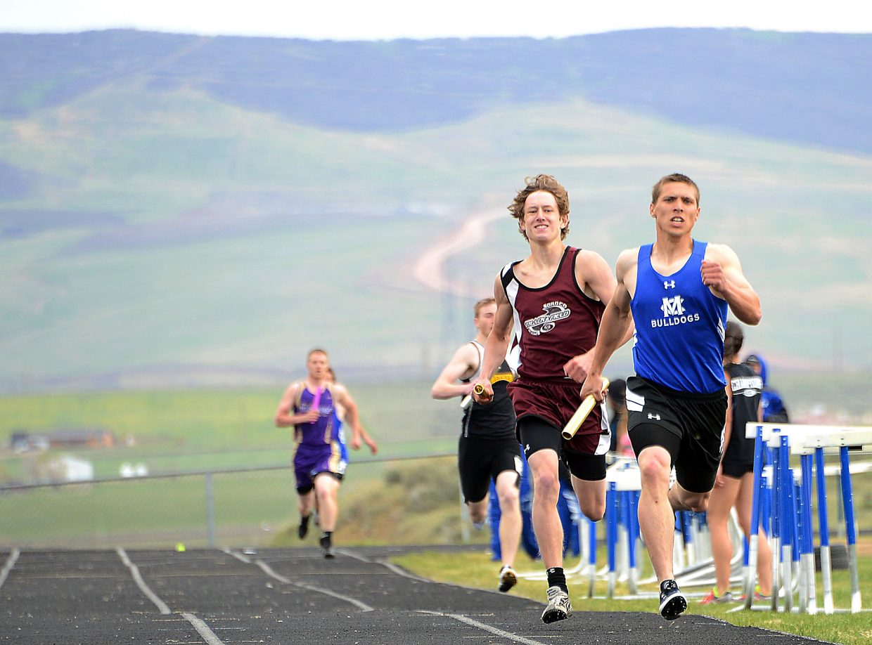 Soroco's Andrew Herzog rumbles down the home stretch during the boys 1,600-meter relay on Friday at the Clint Wells Invitational in Craig. The Soroco boys finished second in the race.