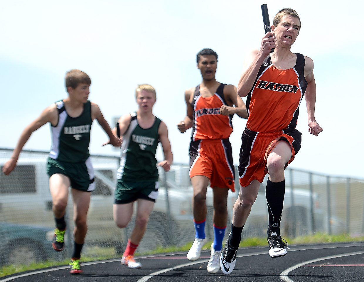 Thomas Rauch takes off with the baton in the boys 800-meter relay on Friday in Craig.
