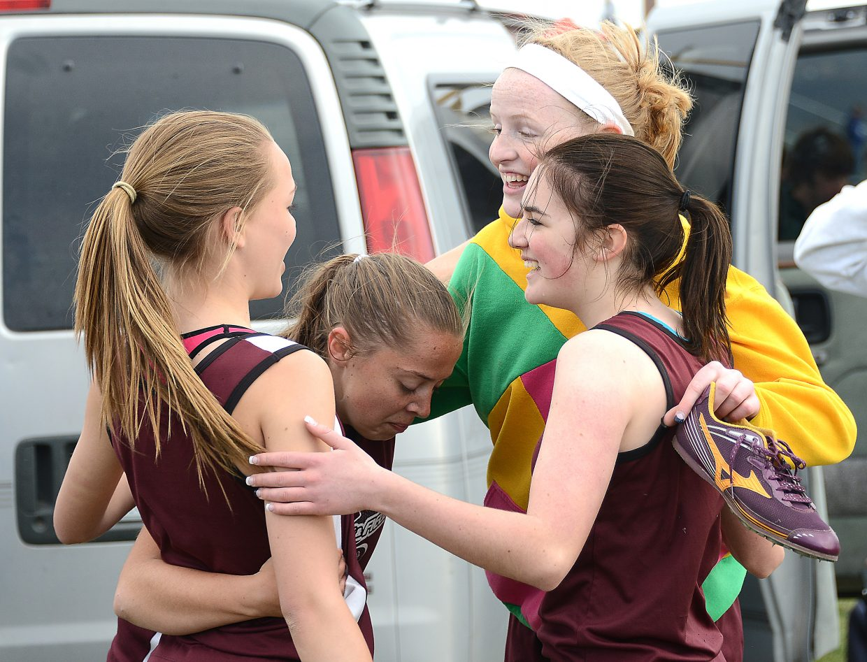 The Soroco girls 1,600-meter relay team of, from left, Kali Constine, DaKota Bruner, Leah Walorski and Hayley Johnson, celebrates and catches its breath after Friday's race at Moffat County High School. Currently ranked 14th in the state, the team is likely to join the 27 relay teams Soroco has sent to state in the last six seasons.